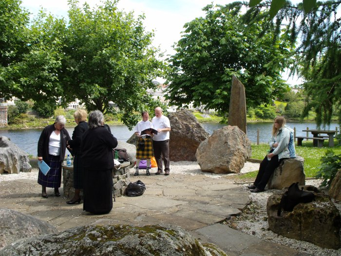The choir practising in the stone circle at Sutherland Mòd