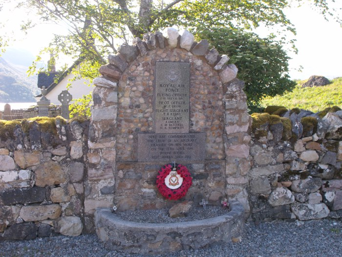 The memorial to airmen killed in a crash on Ben More during WWII: names set in stone and a poppy wreath