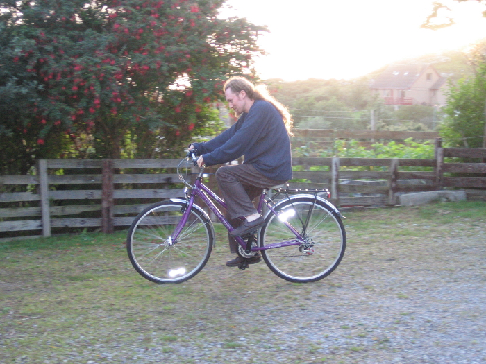 Bicycling is one very good way of getting fit, especially up these hills! This is Robert riding my bike on our drive.