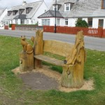 Attractively carved memorial bench offering a haven of peace and a good place to stop for a picnic lunch!