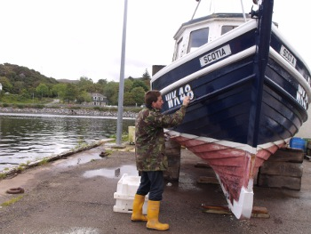 Derek sprucing up his boat