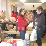 Folk enjoying a cup of mulled wine or apple, a mince pie and a natter at the Elphin winter market