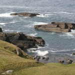 In spite of the calm weather, the sea still boils on the rocks below Stoer Head