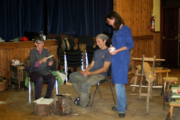 Jorine takes a break from her woolly duties to watch Chris teaching Lesley to make a spoon