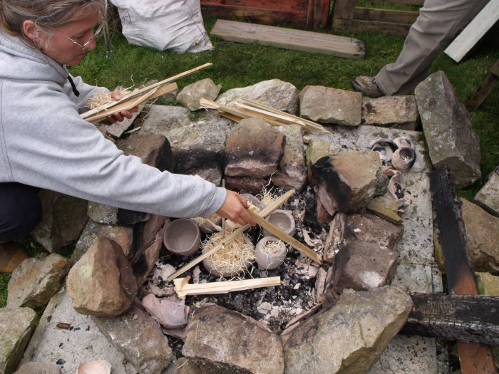 Mandy setting the second fire