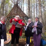 Preparing to sing in front of the wigwam