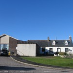 Scourie Village Hall under a peerless autumn sky