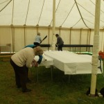 Setting up the craft and produce tent