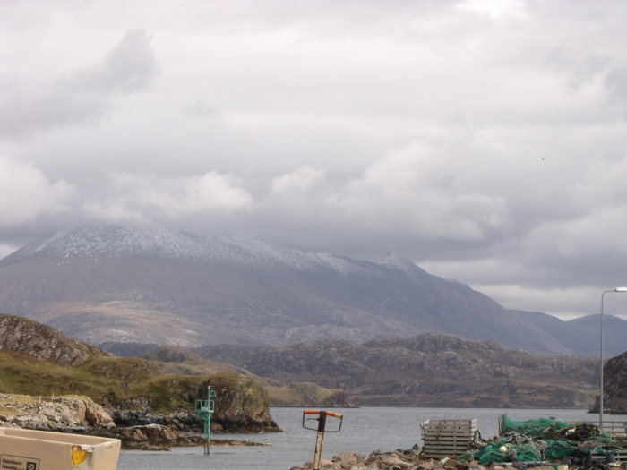 Snow and cloud covered Foinavon taken from the harbour