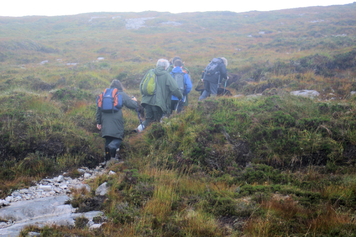 Some of the party setting off up the narrow, inconspicuous man-made path up the mountain