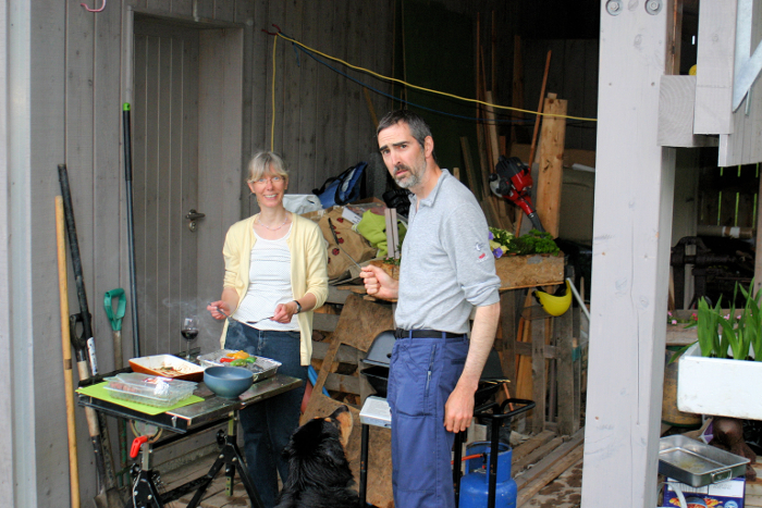 Stewart and Andrea slaving over a hot barbecue (in the rain!)