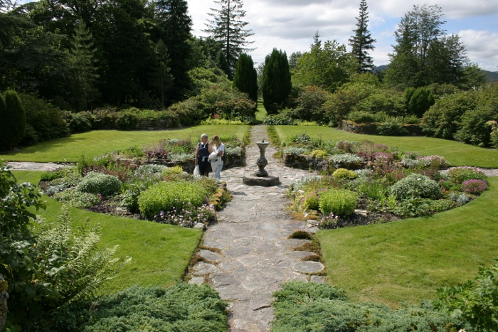 Picture of a sundial in the middle of a path in a Scottish Highlands garden