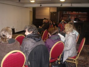 The audience settling down