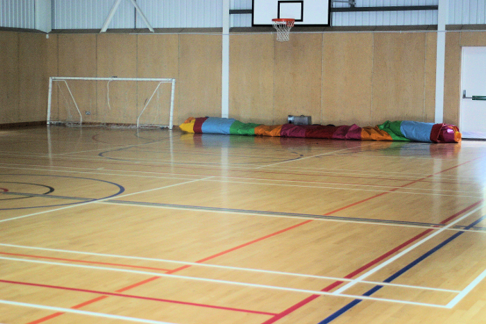 The bouncy castle lives rolled up in the gym when not in use. At this time of year, we share the gym with nesting swallows!