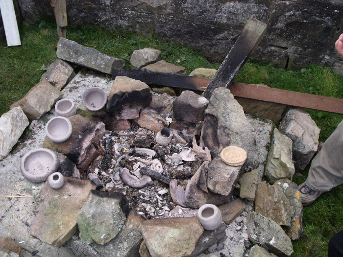 The first firing finished - showing pots and remains of the fire