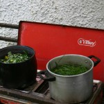 The pots of dye stuff starting to cook on the camping stove in our 'dye kitchen'