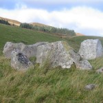 The ring of stones marking the top of the larger of the two cairns.