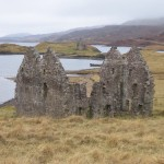 The ruins of Ardvreck Castle seen through the equally ruined