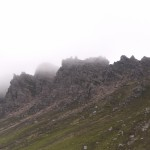 The sharp top of the mountain wreathed in mist