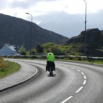 Two cyclists holidaying the hard way with the rump of Fionavon in the background