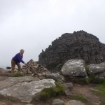 Yours truly doing the traditional thing and adding a stone to the cairn